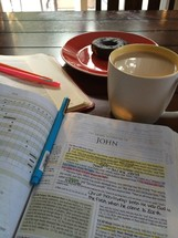 highlighted pages of a Bible, John, coffee and donuts, Bible study