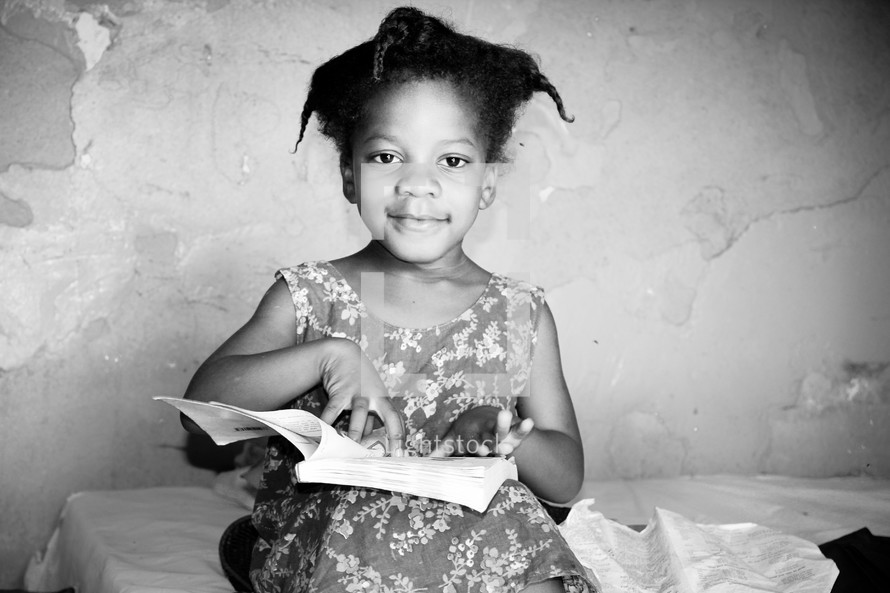 girl child reading a Bible