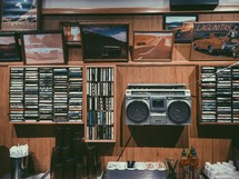 music history, cassette tapes, records, and boombox