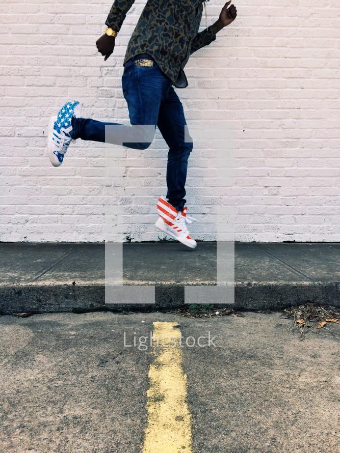 man in hightop sneakers running