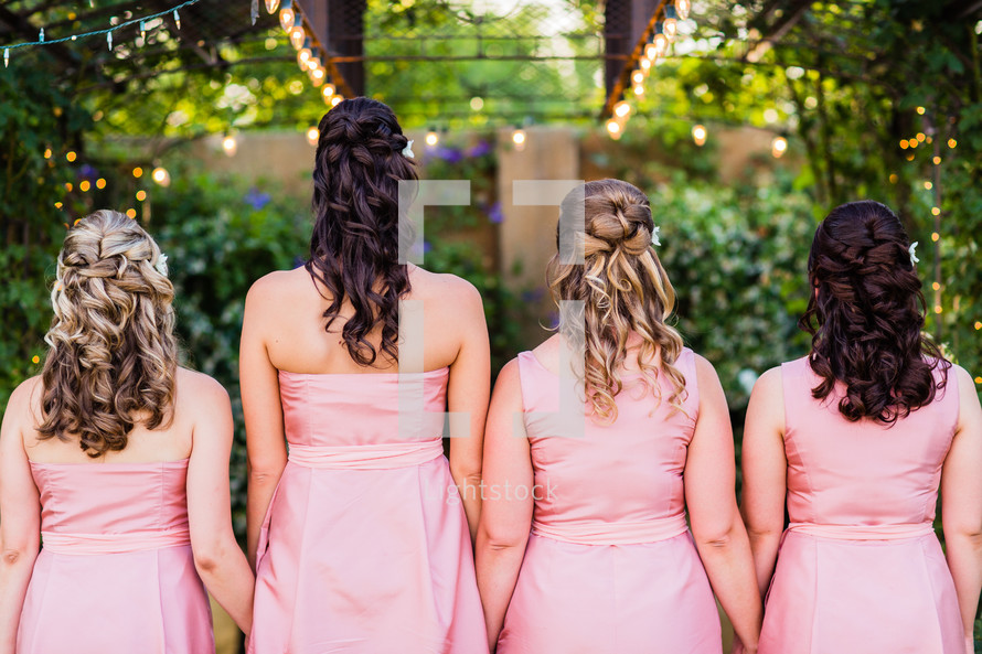 woman's hair style and pink dress bridesmaids wedding