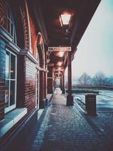 wet sidewalk at a train station