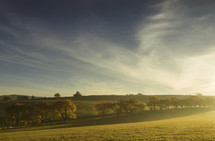 sunburst over a hillside