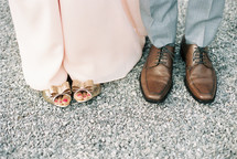 feet of a couple standing together
