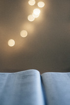 bokeh lights and open Bible