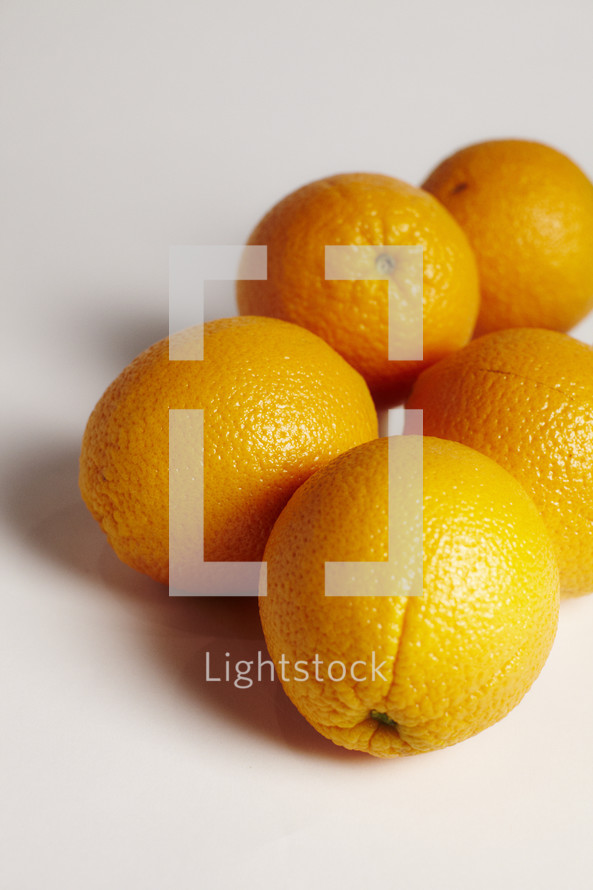 A bunch of oranges isolated on white