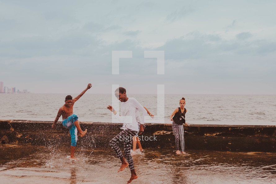 teens playing in the ocean