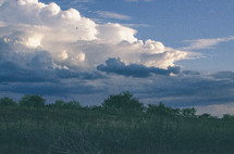 Cloud formations over a meadow.