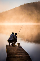 father and son fishing on a pier