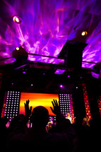Worship concert service lighting pink yellow orange hands raised church service