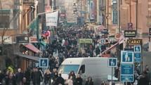 pedestrians on a crowded city sidewalk