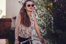 a woman on a bike in a garden