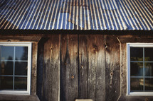 An old cabin with a tin roof