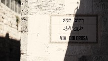 man walking the streets of Via Dolorosa, Israel