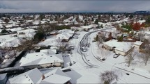 drone flying over a neighborhood after a winter snow storm