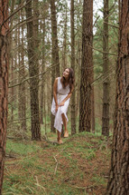 a young woman alone in the forest