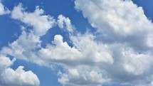 moving clouds in a blue sky