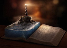lighthouse beacon on the pages of a Bible