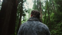 a man hiking through a forest