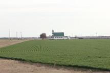 a church and farmland