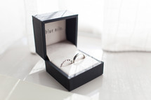 wedding bands in a jewelry gift box