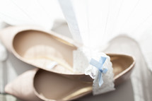 heels and garter for a wedding