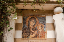 tile mosaic of Mary and baby Jesus in Israel