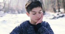 teen boy in thought