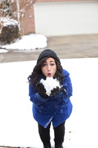 a woman holding a snowball