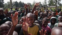 kids waving at the camera