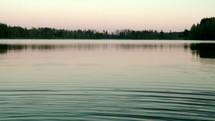 Ripples moving across still lake