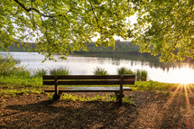 park bench with a lake view