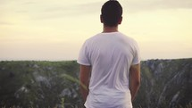 man standing quietly outdoors