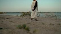 Jesus walking on a shore