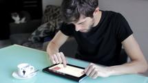 man looking at a tablet screen