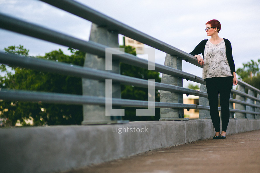 woman standing on a bridge