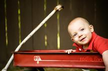 infant boy sitting in a wagon