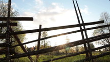 rustic fence on rural farmland