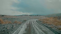 dirt road through a barren landscape