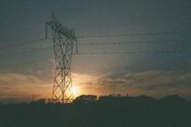 sun setting behind Power lines