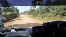 vehicle driving on a dirt road in africa