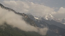 clouds moving over a mountain