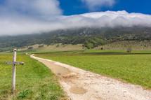 cross beside a rural road in France