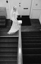 a bride walking down stairs
