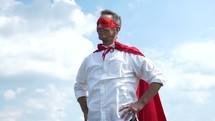 a father in a superhero cape