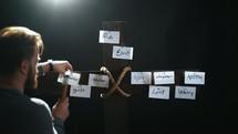 man nailing sins to the cross