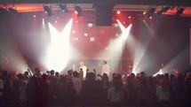 Christian rock band singing at a concert