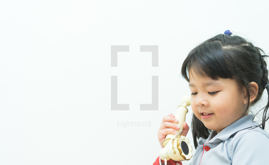 girl talking on a vintage telephone