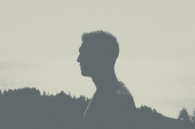 silhouette of a man's side profile.