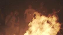 Friends around a campfire.